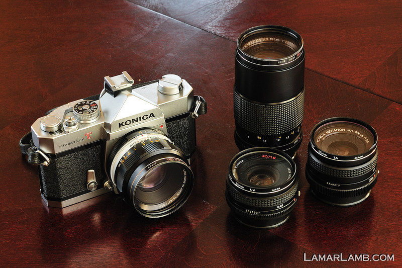 My father's Konica AutoReflex T2 and a few lenses.