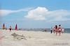 Midday on St. Simons Island Beach, 4th of July Weekend, 2013. Camera - Nikon Nikkormat FT2; Lens - Nikkor 35-200mm f/3.5-4.5 AIs; Film - Kodak Ektar 100  scanned with Nikon Coolscan V ED using VueScan 9 software.