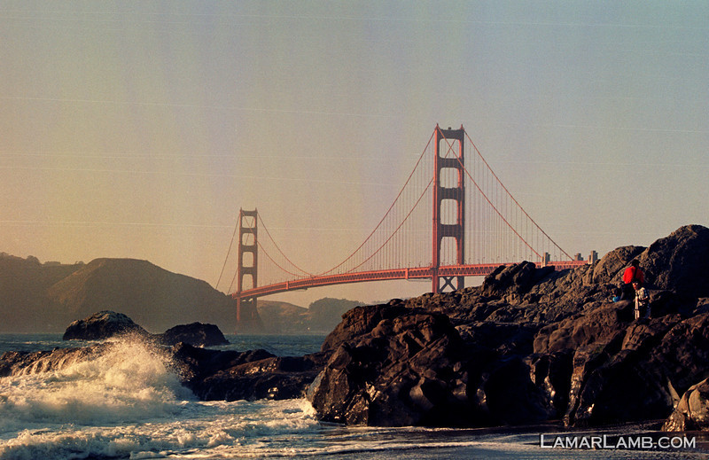 Golden Gate Bridge at sunset taken from Baker Beach. Camera - Nikon FM; Lens - Nikkor 35-200mm f/3.5-4.5 AIs; Film - Kodak Ektar 100 developed in Rollei Digibase C41 Chemicals.  Scanned with Nikon CoolScan V ED.