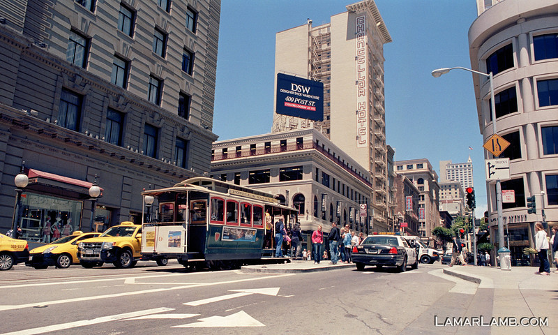 North bound cable car stopped at Powell and Post Street in front of the St. Francis Hotel. Taken from Union Square, San Francisco, California. Camera - Nikon FM; Lens - Nikkor 24mm f/2.8 AIs; Film - Kodak Ektar 100 developed in Rollei Digibase C41 Chemicals.  Scanned with Nikon CoolScan V ED.