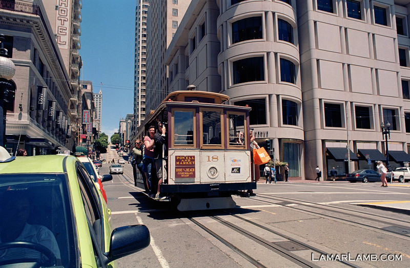 South bound cable car on Powell Street crossing Post Street, San Francisco, California. Camera - Nikon FM; Lens - Nikkor 24mm f/2.8 AIs; Film - Kodak Ektar 100 developed in Rollei Digibase C41 Chemicals.  Scanned with Nikon CoolScan V ED.