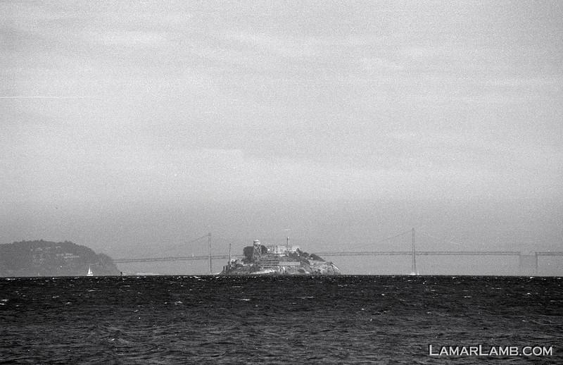 Hazy shot of Alcatraz from Sausalito, CA.  Camera - Nikon FM; Lens - Nikkor 35-200mm f/3.5-4.5 AIs; Film - Ilford PanF Plus 50 developed in Kodak XTOL.  Scanned with Nikon CoolScan V ED.