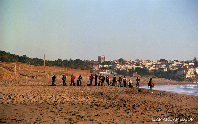 Photography class on Baker Beach setting up to take pictures of the Golden Gate Bridge.  Camera - Nikon FM; Lens - Nikkor 35-200mm f/3.5-4.5 AIs; Film - Kodak Ektar 100 developed in Rollei Digibase C41 Chemicals.  Scanned with Nikon CoolScan V ED.