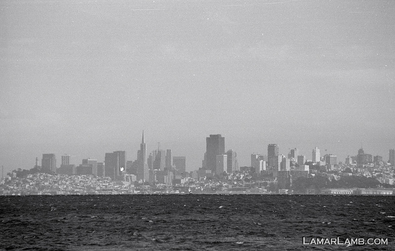 Hazy shot of San Francisco, CA from Sausalito, CA..  Camera - Nikon FM; Lens - Nikkor 35-200mm f/3.5-4.5 AIs; Film - Ilford PanF Plus 50 developed in Kodak XTOL.  Scanned with Nikon CoolScan V ED.