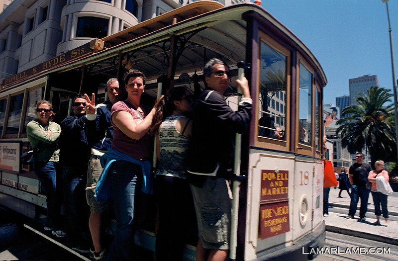 South bound cable car on Powell Street at Union Square, San Francisco, California. Camera - Nikon FM; Lens - Nikkor 24mm f/2.8 AIs; Film - Kodak Ektar 100 developed in Rollei Digibase C41 Chemicals.  Scanned with Nikon CoolScan V ED.