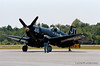 "This beautifully restored F4U-4 Corsair ""Korean War Veteran"" flew off the USS Boxer and USS Valley Forge during the Korean War and still has visible battle damage repair to prove it.  - 2013 Vidalia Airshow -  Camera: Nikon F100; Lens: Nikkor 80-400mm f/4.5-5.6 AF-D VR; Film: Kodak Portra 400; Scanned with Nikon CoolScan V-ED using VueScan 9.2.09 software."