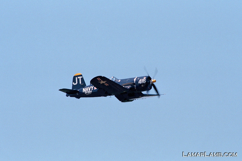 """This beautifully restored F4U-4 Corsair """"Korean War Veteran"""" flew off the USS Boxer and USS Valley Forge during the Korean War and still has visible battle damage repair to prove it.  - 2013 Vidalia Airshow -  Camera: Nikon F100; Lens: Nikkor 80-400mm f/4.5-5.6 AF-D VR; Film: Kodak Portra 400; Scanned with Nikon CoolScan V-ED using VueScan 9.2.09 software."""