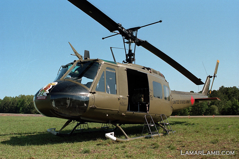 "The Sky Soldier's UH-1H Huey. It served in Vietnam in 1971 with the 101st Airborne Division ""The Comancheros"". Battle damage repair work is visible adding character to this war veteran. - 2013 Vidalia Airshow - Camera: Nikon F2 Photomic; Lens: 35mm f/1.4 Nikkor-N Auto; Film: Kodak Portra 160; Scanned with Nikon CoolScan V-ED using VueScan 9.2.09 software."