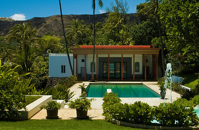 A 75-foot swimming pool, water terraces, white marble steps, palm trees and a tropical garden connect the main house and the Playhouse.