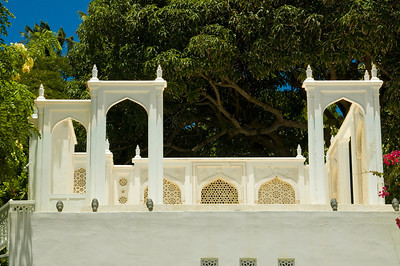Shangri La is situated on a 4.9-acre oceanfront lot in the exclusive Black Point residential neighborhood near Diamond Head, Hawaii. Shagri La is an Islamic-style mansion built by heiress Doris Duke. It is now owned by the Doris Duke Foundation for Islamic Art in cooperation with the Honolulu Academy of Arts, and open to the public for tours; an admission fee is charged.  Construction of Shangri La began in 1937, after Doris Duke's 1935 honeymoon which took her through the Islamic world. For nearly 60 years afterwards, Miss Duke commissioned and collected artifacts for the house, forming a collection of about 3,500 objects. It was designed by Marion Sims Wyeth.  Shangri La is furnished with art, furnishings and built-in architectural elements from Iran, Morocco, Turkey, Spain, Syria, Egypt and India. The Playhouse is a reduced-scale version of the 17th century Chehel Setun in Esfahan, Iran. The outdoor landscaping blends the formality of an Indian Mughal garden and terraced water features with the intimacy of a private Hawaiian fishpond, tropical garden, and fabulous vistas of the Pacific Ocean. Gilt and painted ceilings from Morocco, vivid ceramics from Iran, intimate interiors from Syria, pierced metalwork and vibrant textiles from Spain to India are among the highlights.