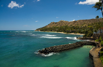 Doris Duke had two ocean walls built to create a spot to park her (first) husband's yacht. Today, locals swim here. Beyond is little Ka'alawai Beach, a perfect cove with views of the lesser-viewed east side of Diamond Head.