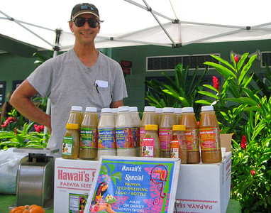 David  with his Papaya Seed Salad Dressing and Pupukea Gardens Baby salad mix   Hawaii's Special Inc.  North Shore Country Market  held at Sunset Elementary School every Saturday morning  Mauka Ehukai Beach Park  North Shore, Oahu, Hawaii  October 31, 2009 - Halloween Day