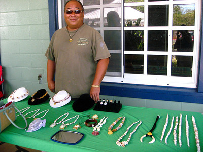 Wendall with his ocean jewelry North Shore Country Market  held at Sunset Elementary School every Saturday morning  Mauka Ehukai Beach Park  North Shore, Oahu, Hawaii  October 31, 2009 - Halloween Day