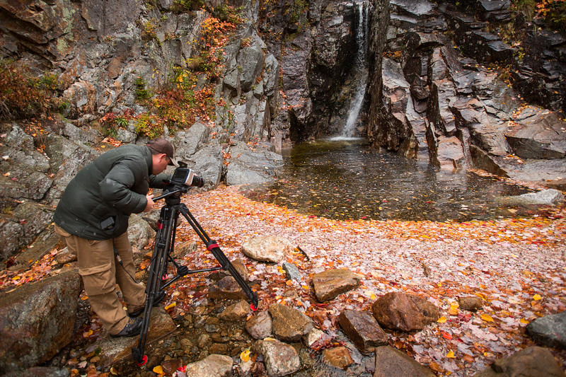 Paul Williams filming fallen leaves at the bottom of a waterfall in the White Mountains.