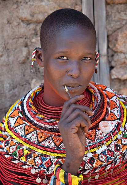 Samburu woman cleaning teeth