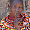 Samburu woman cleaning teeth