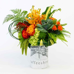 An assortment of bright greens mixed with orange roses