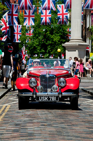 Vintage MG passing through Covent Garden, London, United Kingdom