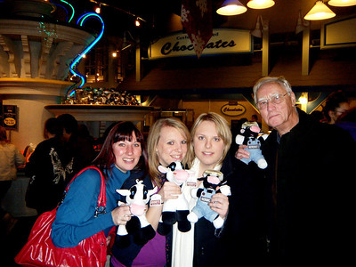Charlotte, Kourtney, Diana, and Dennis (Granddad) grabbed the available props for this picture from the stand behind them.  Dennis seems less than thrilled with his very own cow though.