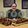 """Bob Myers of DeKalb poses with his replicas of Sycamore Fire Department's 1923 Stutz fire engine and of a locomotive nicknamed """"The Judge."""""""
