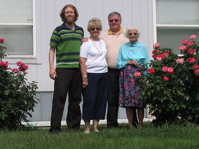 Me, Grandma Marty, Dad, and Aunt Peggy with some of Peggy's roses.