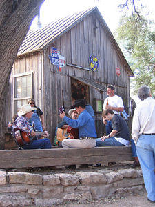 No sign of Willie or Waylon, but the boys were out pickin' behind the bar at Luckenbach TX