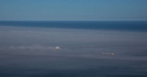 Supertankers heading into the mist off the coast of Gibraltar