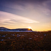 Western Landscape at Sunset on the Prairie with Low Mountains in the Background in Colorado