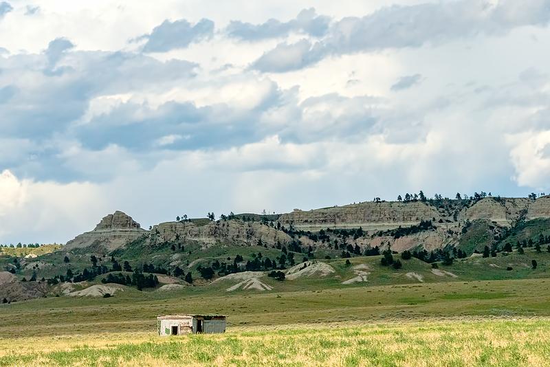 Shack on the prairie below the hills