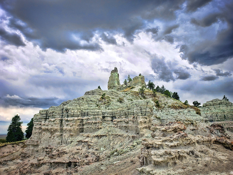 capitol rock and storm clouds