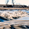 "Do not cross here, at least not when the spring ice and water floods the Three V crossing, north of Marmarth on the Little Missouri River.<br /> <br /> You can own this print. Just click ""buy."""