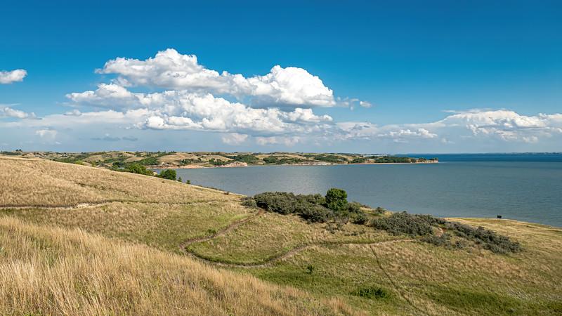 Blue Skies, Puffy Summer Clouds Over Lake Sakakawea on the Nux Baa Ga Trail, Indian Hills, North Dakota