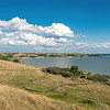 Blue Skies, Puffy Summer Clouds Over Lake Sakakawea on the Nux Baa Ga Trail, Indian Hills, North Dakota