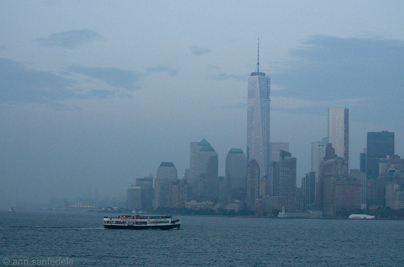 The Battery, the Circle Line boat and the Freedom Tower - from the Staten Island Ferry at dusk - on a very hazy day.<br /> (yeah, lotsa noise)