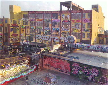 From the 7 train. Five points (5 points) From a pretty reliable source I've been told this was a kind of street art project , done with the permission of the building's owner(s).  Just grabbed this with the cell from the elevated train window.  brought out the shadows and saturation in photoshop.. the original was much too dark.
