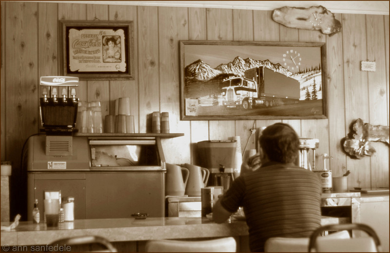"""Cafe with truck clock art (yeah, the lights on the truck glow.) Near Brawley, California - 1982. <p> Apparently gone, but may not be.  The name of the cafe is """"The Gate Way"""" - try searching <i>that</i> on google :-)"""