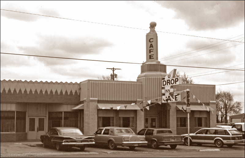 U Drop In Café – Shamrock, Tx – 1987. If the building's structure looks familiar it may be because it was next to a  FINA gas station.  Both buildings are now part of a Route 66 historical preservation project so these days at least the funky architecture can still be admired.  As I recall, the food at the U Drop Inn was not so good.