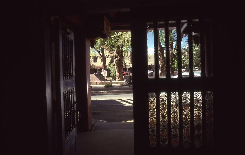 Looking out from La Fonda de La Sol at the Taos Plaza