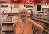 A young gas station attendant aspires to own a camera like mine and I let her try it out  - the background is an accident - she didn't know my name :)<p> I think it's a fine photo of me - I gave her my card and hope she will find her way here so I can credit her...