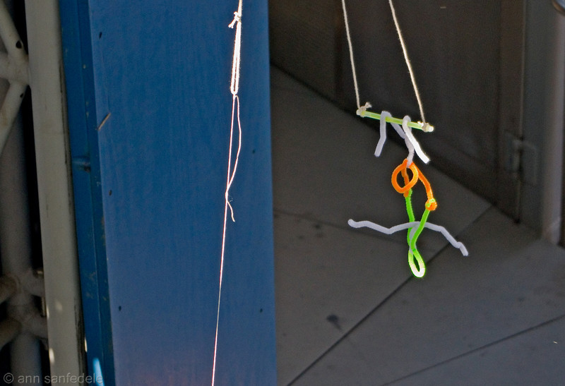 Pipe cleaner trapeze artists on the High line