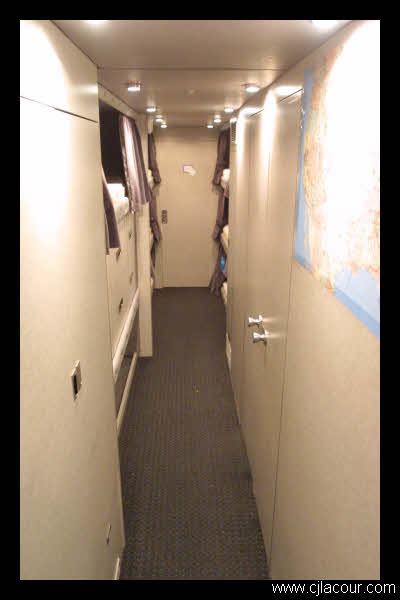 The hallway. Here we have two closets, personal drawers, personal duffel bags, our bunks, musical instrument storage, the bathroom, and the shower. On the right you can see a map where we highlight our route