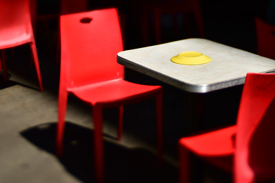 Red Chairs. Yellow Plate.