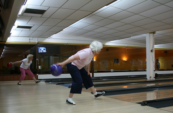 Anne Jennings and Sue Garrett (in the background) throwing in unison