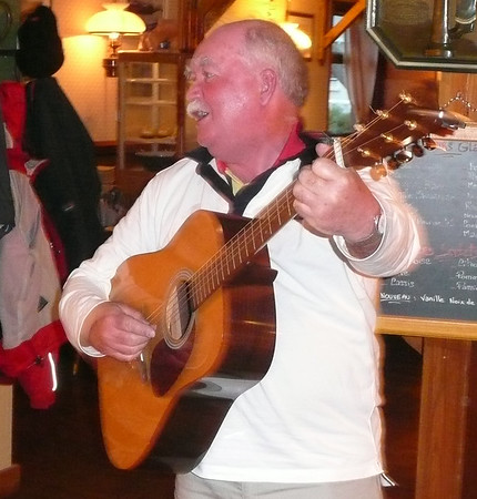 Peter Wallace leads the sing-song in Carentan