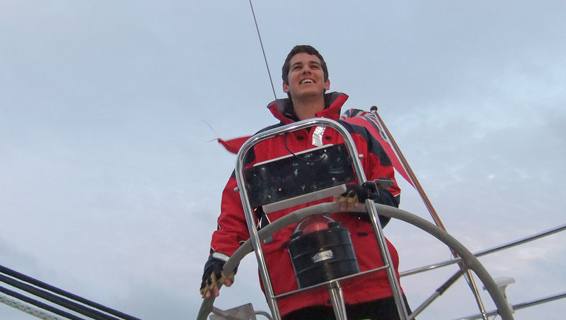 Young Harry Reynolds at the helm of SYCORAX