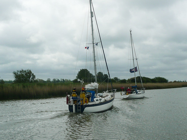 L'aquarelle leads guest boat, Pheon, up the Carentan Canal