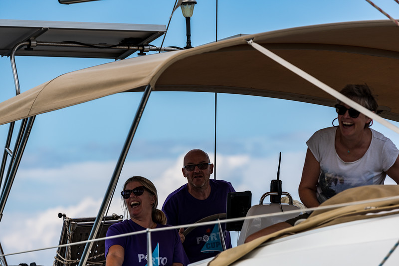 The crew on Sunshine share a joke with the Committee boat