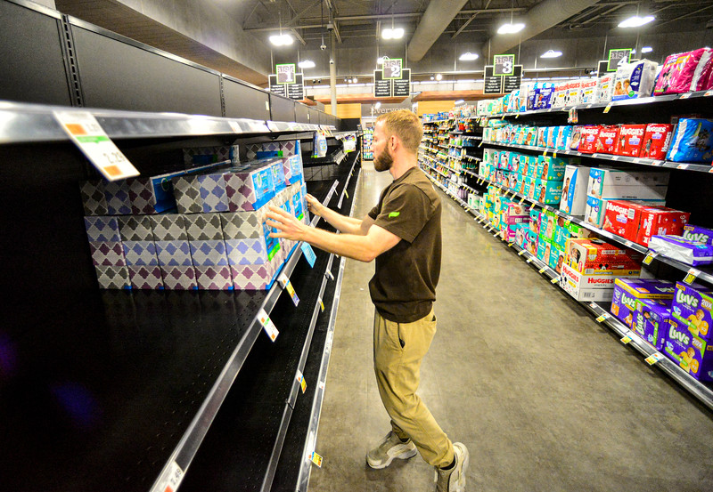 KRISTOPHER RADDER — BRATTLEBORO REFORMER<br /> Derek Oliva, the night manager at Market 32 by Price Chopper, in Brattleboro, Vt., puts up an order of tissues as they work through the night to make sure everything is up for people as they buy supplies during the COVID-19 outbreak on Tuesday, March 17, 2020.