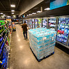 KRISTOPHER RADDER — BRATTLEBORO REFORMER<br /> Shawn Lynch, assistant manager at Market 32 by Price Chopper, in Brattleboro, Vt., puts up cases of water as the team works through the night to make sure everything is up for people as they buy supplies during the COVID-19 outbreak on Tuesday, March 17, 2020.