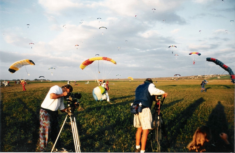 Four of the most miserable, and amazing weeks I have ever experienced were living on a Russian Airforce base in Anapa [near the Black Sea] for the World Team '96 Skydiving Freefall Formation World Record attempts. Here, Henry Boger and I capture some of the 300+ canopies descending on us from the sky.<br /> <br /> Photo credit: Jan Davis